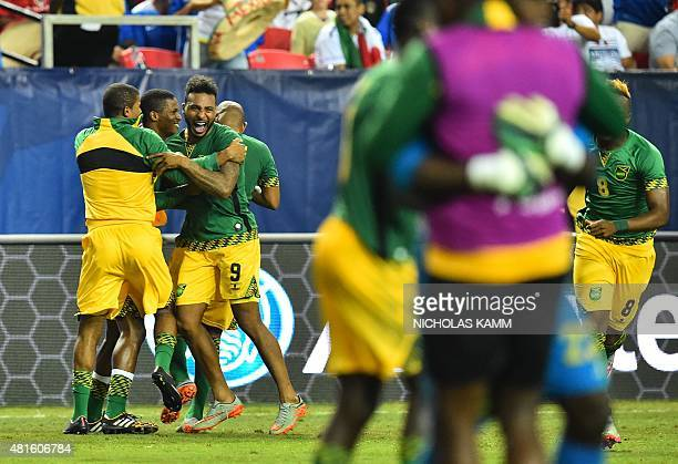Jamaica's Giles Barnes and teammates celebrate defeating the US 21 in a CONCACAF Gold Cup semifinal football match in Atlanta on July 22 2015 AFP...