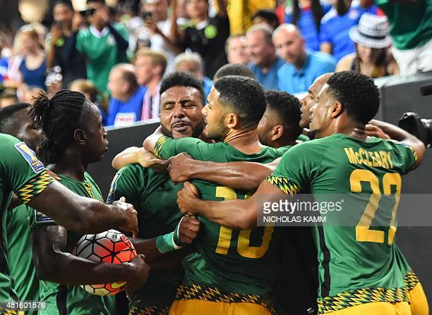 Jamaica's Giles Barnes and teammates celebrate scoring against the US during a CONCACAF Gold Cup semifinal football match in Atlanta on July 22 2015...