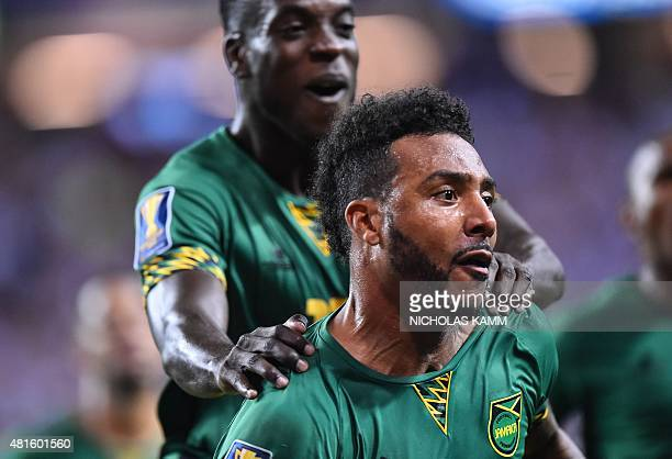 Jamaica's Giles Barnes celebrates scoring against the US during a CONCACAF Gold Cup semifinal football match in Atlanta on July 22 2015 AFP...