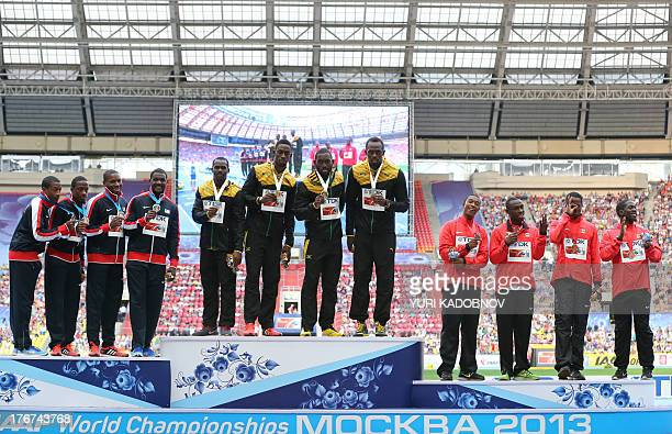 Jamaica's gold medalists athletes US silver medalist athletes and Canada's bronze medalists athletes pose on the podium during the medal ceremony for...