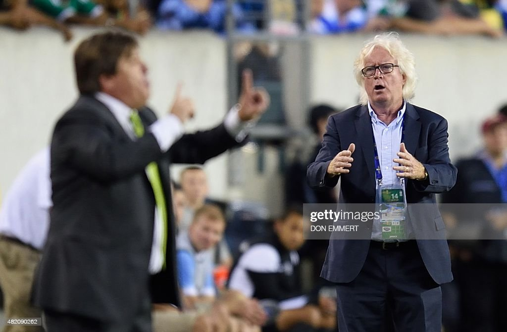 Jamaica's head coach Winfried Schäfer (R) reacts on the sidelines as Mexico's head coach <a gi-track='captionPersonalityLinkClicked' href=/galleries/search?phrase=Miguel+Herrera+-+Entrenador+de+f%C3%BAtbol&family=editorial&specificpeople=12319687 ng-click='$event.stopPropagation()'>Miguel Herrera</a> gestures during the 2015 CONCACAF Gold Cup final between Jamaica and Mexico in Philadelphia on July 26, 2015.