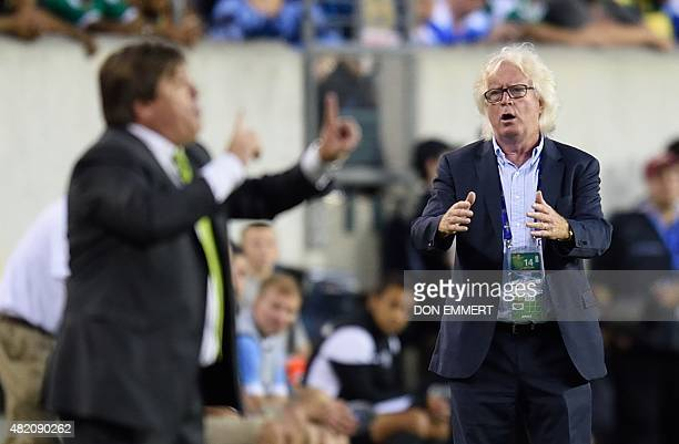 Jamaica's head coach Winfried Schäfer reacts on the sidelines as Mexico's head coach Miguel Herrera gestures during the 2015 CONCACAF Gold Cup final...
