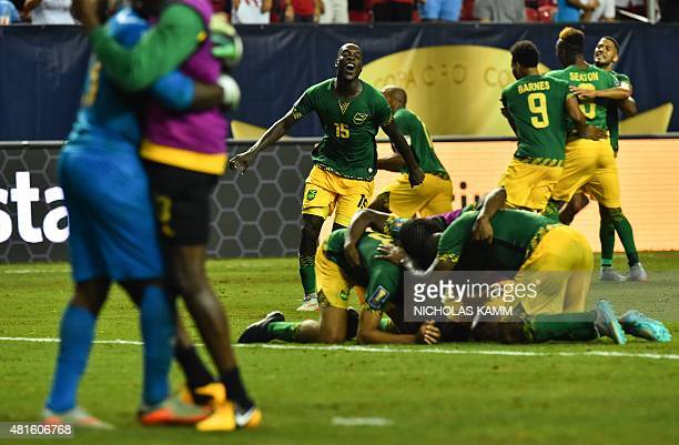 Jamaica's JeVaughn Watson and teammates celebrate defeating the US 21 in a CONCACAF Gold Cup semifinal football match in Atlanta on July 22 2015 AFP...