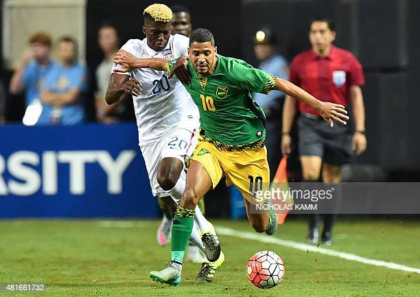 Jamaica's Joel McAnuff vies with Gyasi Zardes of the US during a CONCACAF Gold Cup semifinal football match in Atlanta on July 22 2015 AFP...
