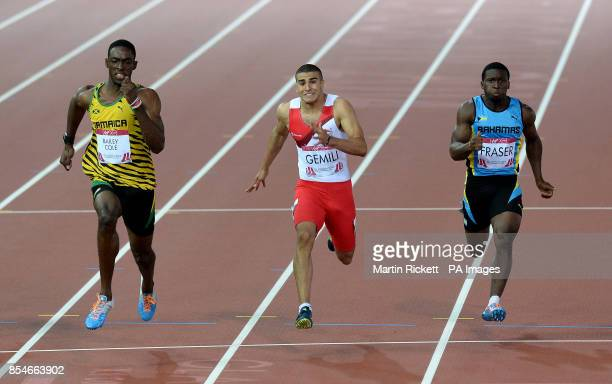 Jamaica's Kemar Bailey Cole goes on to win ahead of second placed England's Adam Gemili in the Men's 100m Final at Hampden Park during the 2014...