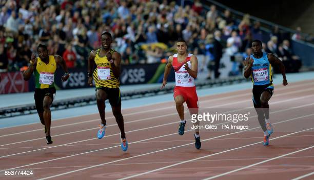 Jamaica's Kemar Bailey Cole on his way to winning ahead of second placed England's Adam Gemili in the Men's 100m Final at Hampden Park during the...