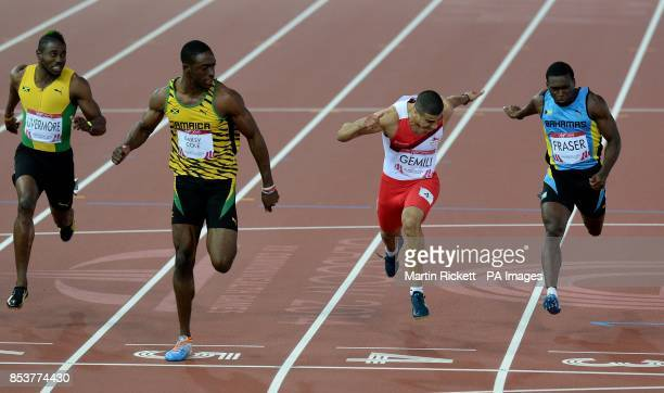 Jamaica's Kemar Bailey Cole wins ahead of second placed England's Adam Gemili in the Men's 100m Final at Hampden Park during the 2014 Commonwealth...