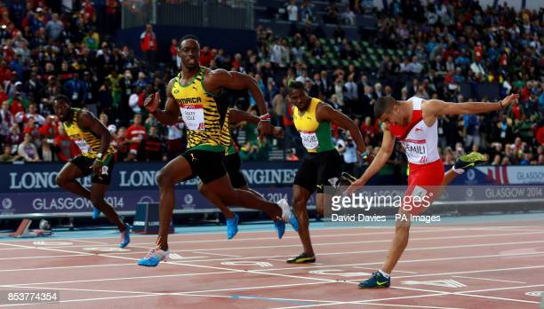 Jamaica's Kemar BaileyCole beats England's Adam Gemili in to second place in the Men's 100m Final at Hampden Park during the 2014 Commonwealth Games...