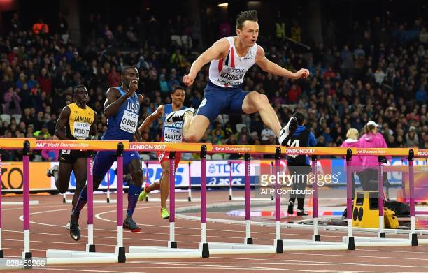 Jamaica's Kemar Mowatt US athlete Kerron Clement and Norway's Karsten Warholm compete in the final of the men's 400m hurdles athletics event at the...