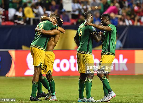 Jamaica's Michael Hector Garath McClearly Wes Morgan and Joel Grant celebrate defeating the US 21 in a CONCACAF Gold Cup semifinal football match in...
