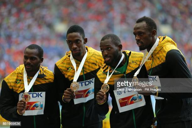 Jamaica's Nesta Carter Kemar BaileyCole Nickel Ashmeade and Usain Bolt celebrate with their gold medals after winning the Men's 4x100 metres relay...