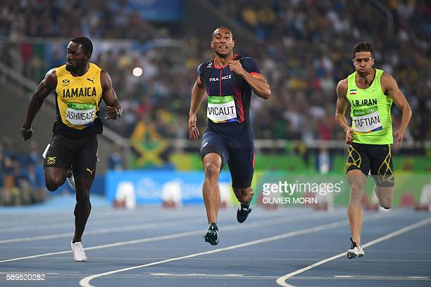 TOPSHOT Jamaica's Nickel Ashmeade France's Jimmy Vicaut and Iran's Hassan Taftian compete in the Men's 100m Semifinal during the athletics event at...