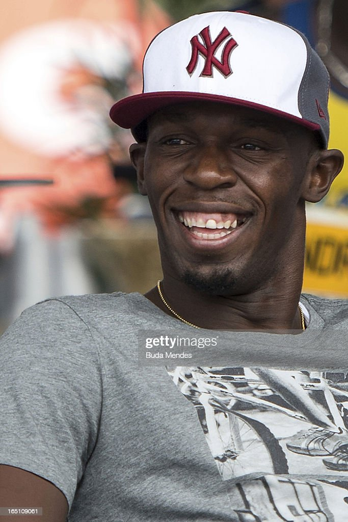 Jamaica's Olympic gold medallist Usain Bolt during a 'Mano a Mano' challenge at Copacabana beach on March 30, 2013 in Rio de Janeiro, Brazil.