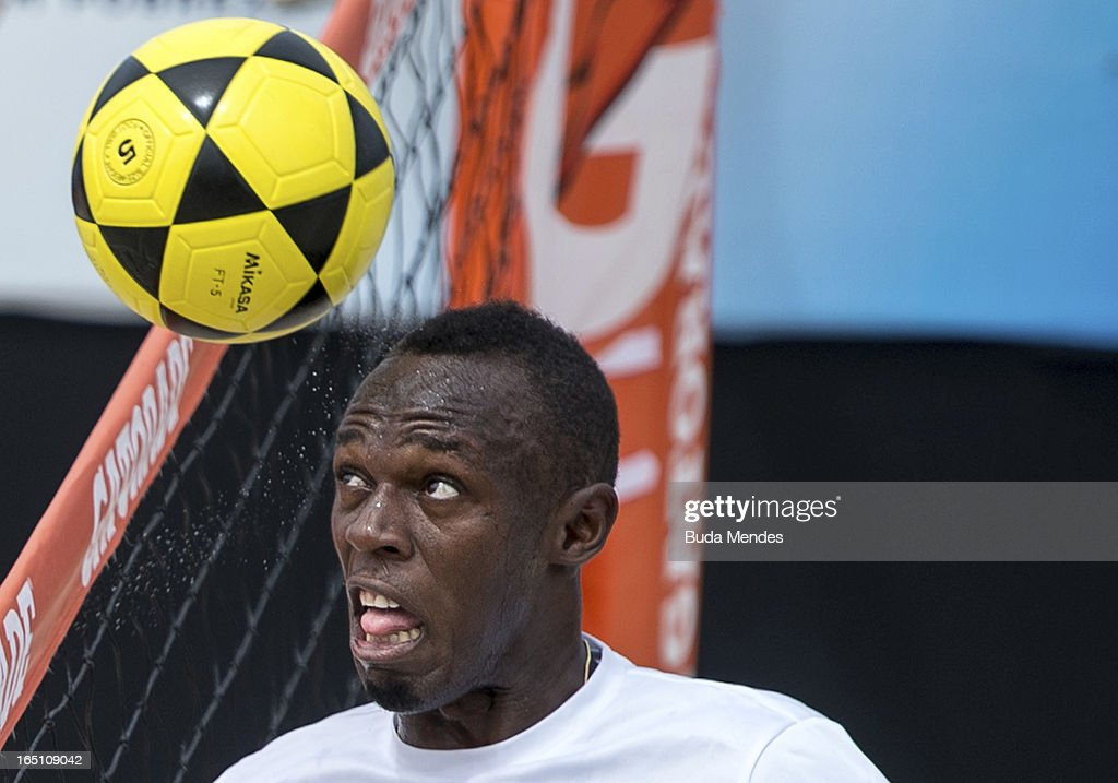 Jamaica's Olympic gold medallist Usain Bolt plays footvolley during a 'Mano a Mano' challenge at Copacabana beach on March 30, 2013 in Rio de Janeiro, Brazil.