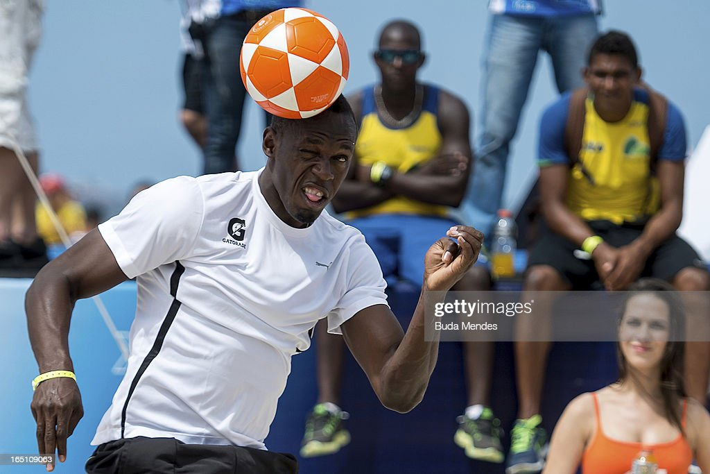 Jamaica's Olympic gold medallist <a gi-track='captionPersonalityLinkClicked' href=/galleries/search?phrase=Usain+Bolt&family=editorial&specificpeople=604196 ng-click='$event.stopPropagation()'>Usain Bolt</a> plays footvolley during a 'Mano a Mano' challenge at Copacabana beach on March 30, 2013 in Rio de Janeiro, Brazil.