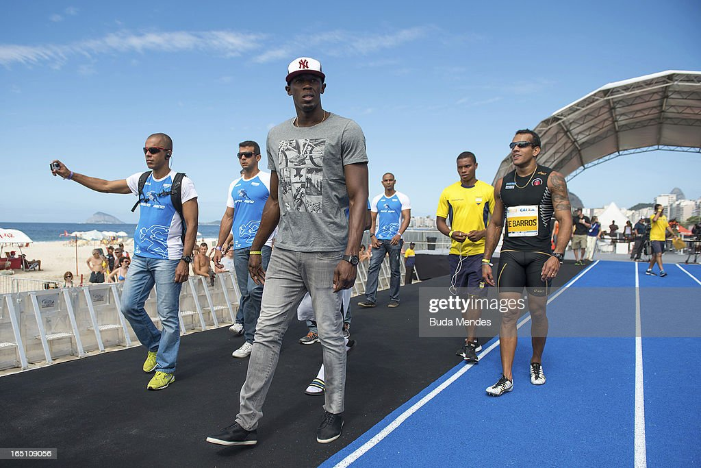 Jamaica's Olympic gold medallist Usain Bolt walks on the runway during a 'Mano a Mano' challenge at Copacabana beach on March 30, 2013 in Rio de Janeiro, Brazil.