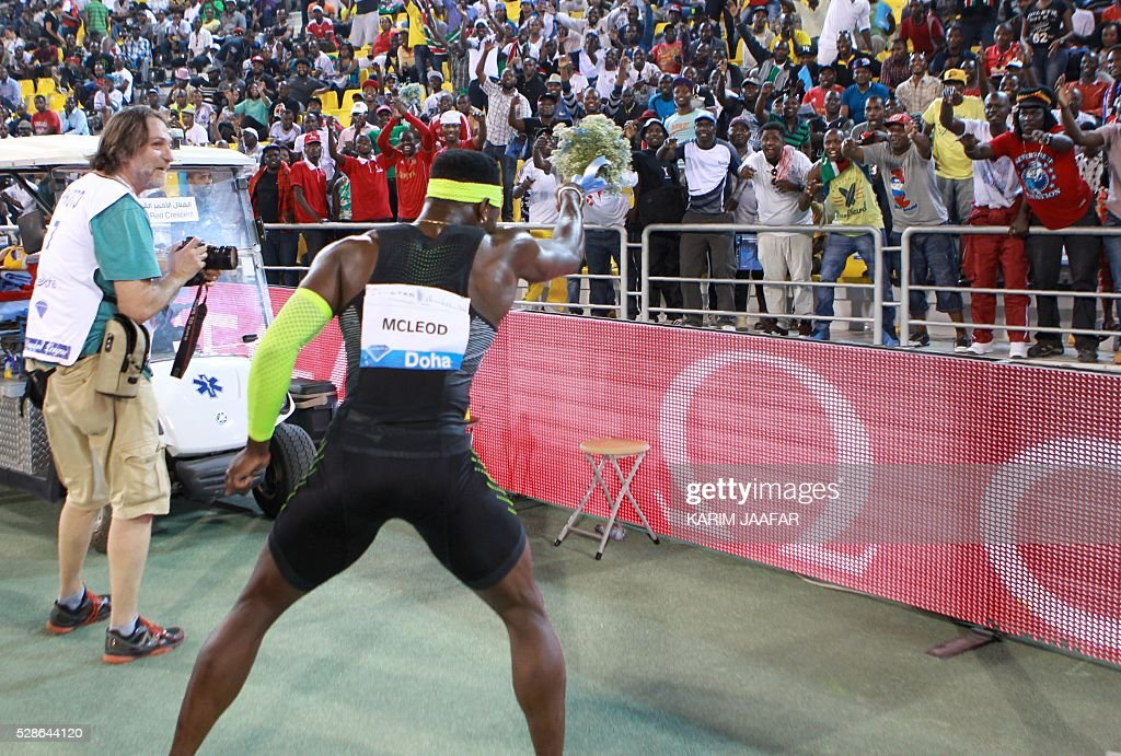Jamaica's Omar McLeod gestures towards the crowd after winning the 110m hurdles event at the Diamond League athletics meeting at the Suhaim bin Hamad Stadium in Doha on May 6, 2016. / AFP / KARIM