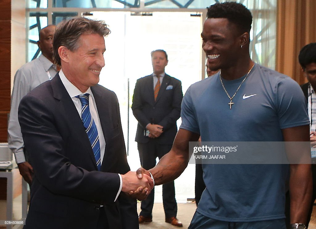 Jamaica's Omar McLeod (R) shakes hands with International Association of Athletics Federations (IAAF)'s president, Sebastian Coe, before a press conference in the Qatari capital Doha on May 5, 2016, on the eve of the Diamond League athletics meeting. / AFP / KARIM
