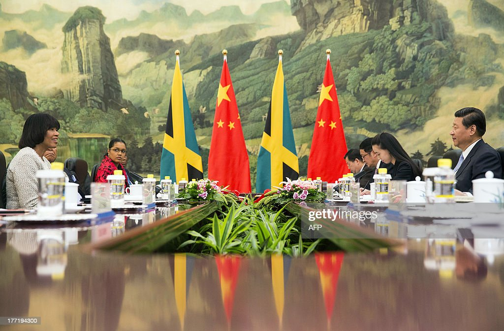 Jamaica's Prime Minister Portia Simpson-Miller (L) and Chinese President Xi Jinping (R) meet for talks at the Great Hall of the People in Beijing on August 22, 2013. Simpson-Miller is on a visit to China from August 20 to 25.