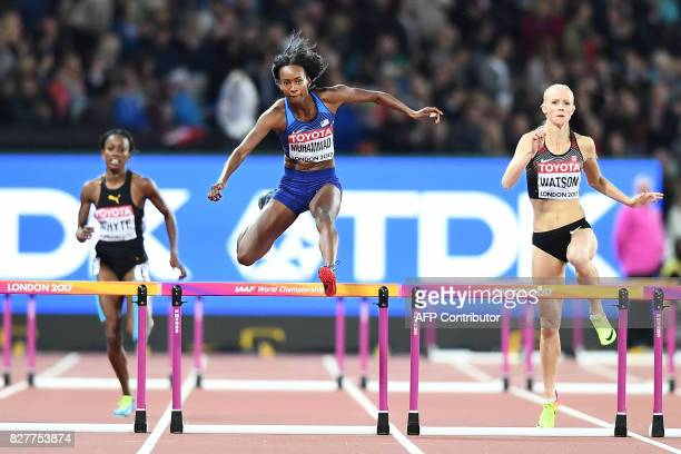 TOPSHOT Jamaica's Rhonda Whyte US athlete Dalilah Muhammad and Canada's Sage Watson compete in a semifinal of the women's 400m hurdles athletics...