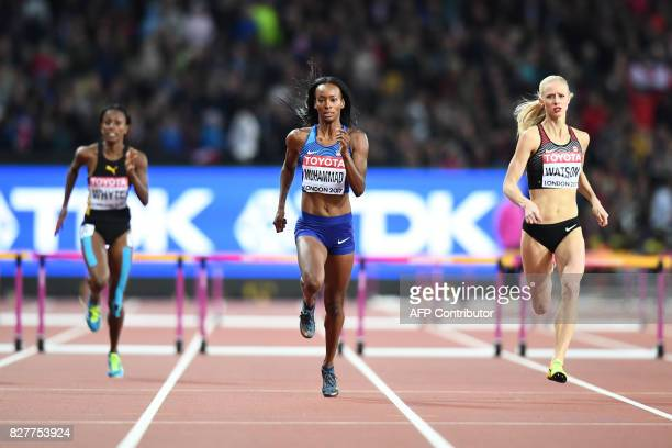 Jamaica's Rhonda Whyte US athlete Dalilah Muhammad and Canada's Sage Watson compete in a semifinal of the women's 400m hurdles athletics event at the...