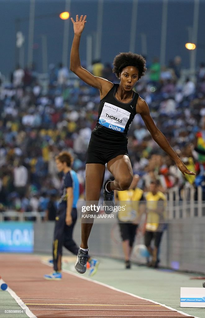 Jamaica's Shanieka Thomas competes in the women's triple jump event at the Diamond League athletics competition at the Suhaim bin Hamad Stadium in Doha on May 6, 2016. / AFP / KARIM