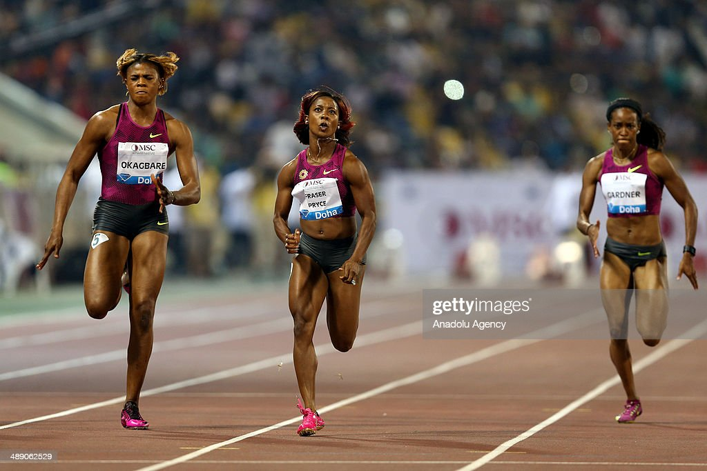 Jamaica's Shelly-Ann Fraser-Price (C) competes in the WOMEN's 100m at the IAAF Diamond League in Doha, Qatar on May 09, 2014.