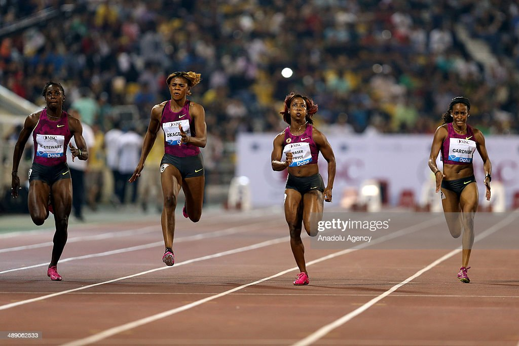 Jamaica's Shelly-Ann Fraser-Price (2nd R) competes in the WOMEN's 100m at the IAAF Diamond League in Doha, Qatar on May 09, 2014.
