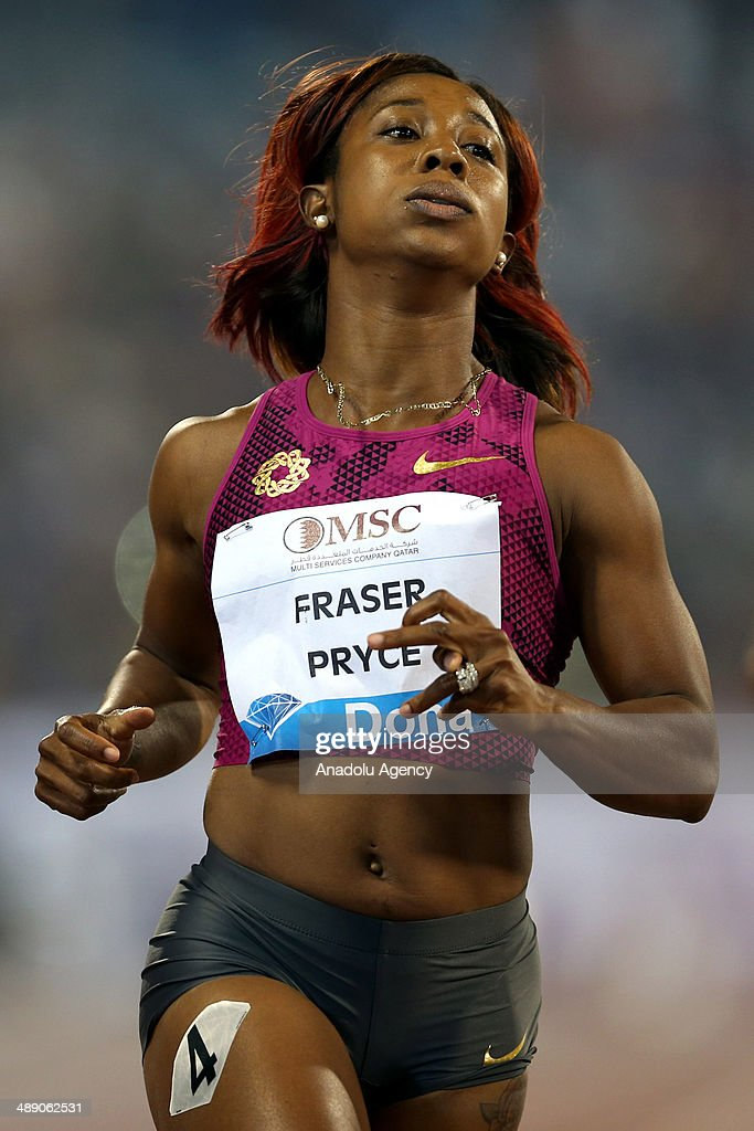 Jamaica's Shelly-Ann Fraser-Price finishes the WOMEN's 100m at the IAAF Diamond League in Doha, Qatar on May 09, 2014.