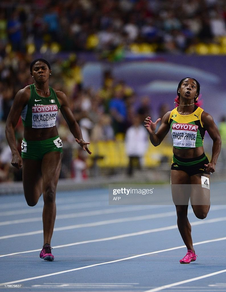 Jamaica's Shelly-Ann Fraser-Pryce (R) and Nigeria's Blessing Okagbare compete during the women's 200 metres final at the 2013 IAAF World Championships at the Luzhniki stadium in Moscow on August 16, 2013.