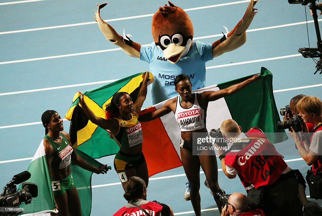 Jamaica's Shelly-Ann Fraser-Pryce (C) celebrates with Ivory Coast's Murielle Ahoure (L) and Nigeria's Blessing Okagbare following the women's 200 metres final at the 2013 IAAF World Championships at the Luzhniki stadium in Moscow on August 16, 2013. Fraser-Pryce timed 22.17 seconds and won gold while Ahoure took silver in a photo finish with Okagbare, both of whom timed 22.32.