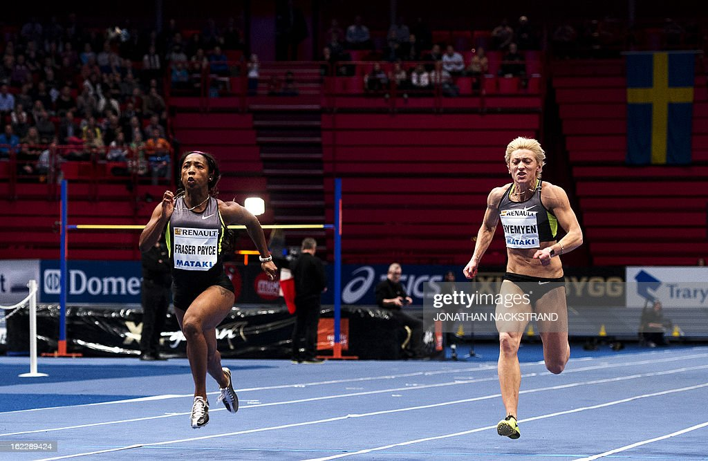 Jamaica's Shelly-Ann Fraser-Pryce (C) competes to win against second placed Ukraine's Mariya Ryemyen (R) during the women's 60m event of the XL Galan Stockholm Athletics Indoor meeting on February 21, 2013 at the Ericsson Globe Arena in Stockholm.