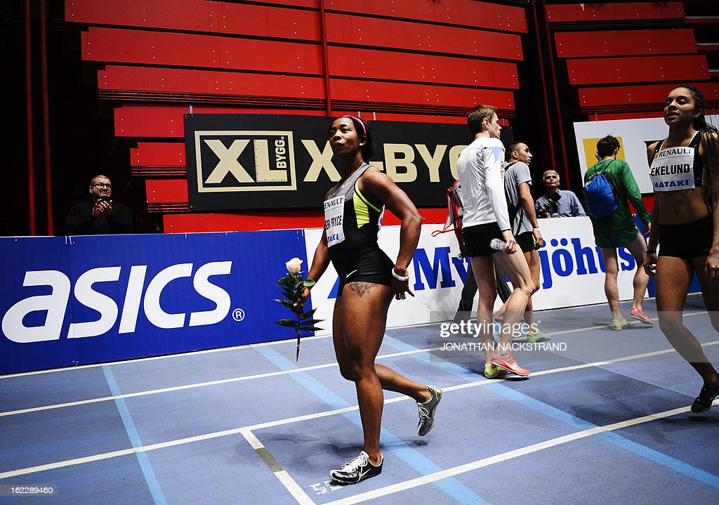 Jamaica's Shelly-Ann Fraser-Pryce (L) reacts as she wins the women's 60m event of the XL Galan Stockholm Athletics Indoor meeting on February 21, 2013 at the Ericsson Globe Arena in Stockholm.