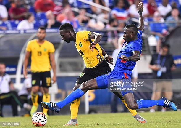 Jamaica's Simon Dawkins is tackled by Haiti's James Marcelin during a CONCACAF Gold Cup quarterfinal football match in Baltimore on July 18 2015 AFP...