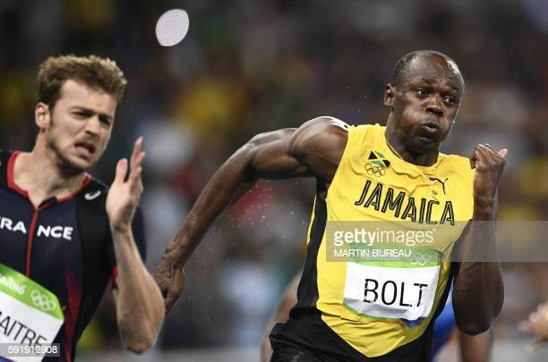 TOPSHOT Jamaica's Usain Bolt and France's Christophe Lemaitre compete in the Men's 200m Final during the athletics event at the Rio 2016 Olympic...