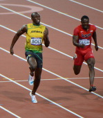 Jamaica's Usain Bolt and Justin Gatlin of the US sprint towards the finish line in the men's 100m final at the athletics event during the London 2012...