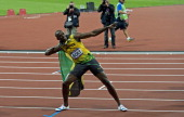 Jamaica's Usain Bolt celebrates after crossing the finish line after winning the 100m men's final during the London 2012 Olympic games at the Olympic...