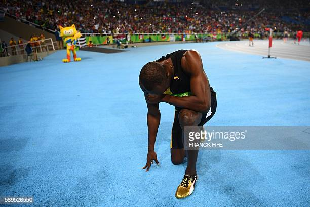 TOPSHOT Jamaica's Usain Bolt celebrates after he won the Men's 100m Final during the athletics event at the Rio 2016 Olympic Games at the Olympic...