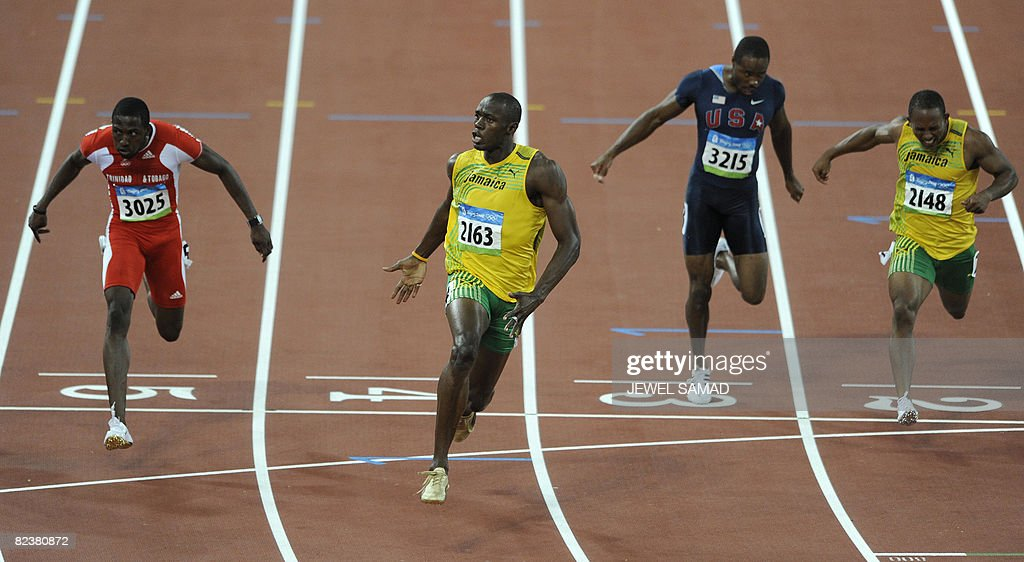 Jamaica's Usain Bolt (2ndL) celebrates after winning ahead of Trinidad and Tobago's Richard Thompson (L) and Walter Dix of the US (2ndR) the men's 100m final at the National stadium as part of the 2008 Beijing Olympic Games on August 16, 2008.