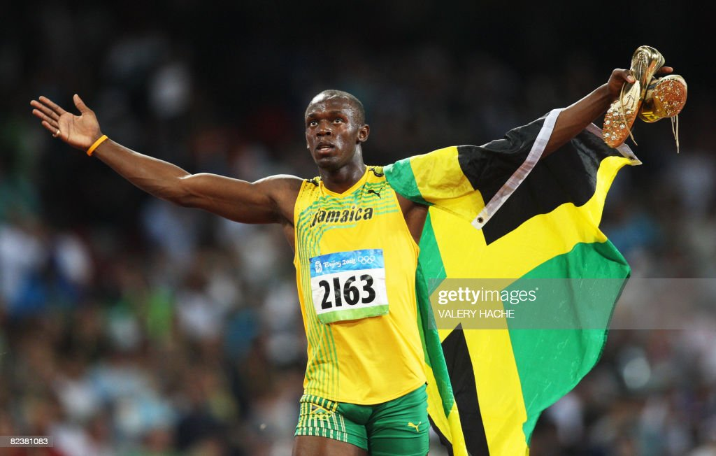 Jamaica's <a gi-track='captionPersonalityLinkClicked' href=/galleries/search?phrase=Usain+Bolt&family=editorial&specificpeople=604196 ng-click='$event.stopPropagation()'>Usain Bolt</a> celebrates after winning the men's 100m final at the 'Bird's Nest' National Stadium as part of the 2008 Beijing Olympic Games on August 16, 2008. Jamaica's <a gi-track='captionPersonalityLinkClicked' href=/galleries/search?phrase=Usain+Bolt&family=editorial&specificpeople=604196 ng-click='$event.stopPropagation()'>Usain Bolt</a> won the Olympic Games men's 100m gold medal in a new world record time of 9.69sec. Trinidad and Tobago's Richard Thompson (9.89sec) and Walter Dix of the US (9.91) took silver and bronze respectively. AFP PHOTO / VALERY HACHE