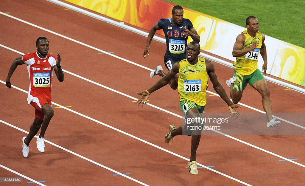 Jamaica's Usain Bolt (front) celebrates after winning the men's 100m final at the 'Bird's Nest' National Stadium during the 2008 Beijing Olympic Games on August 16, 2008. Bolt won the Olympic Games men's 100m gold medal in a new world record time of 9.69sec. Trinidad and Tobago's Richard Thompson (9.89sec) and Walter Dix of the US (9.91) took silver and bronze respectively.