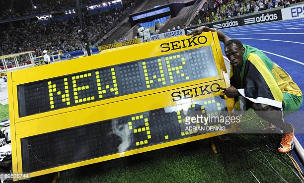 Jamaica's Usain Bolt celebrates after winning the men's 100m final race of the 2009 IAAF Athletics World Championships ahead of US Tyson Gay and...