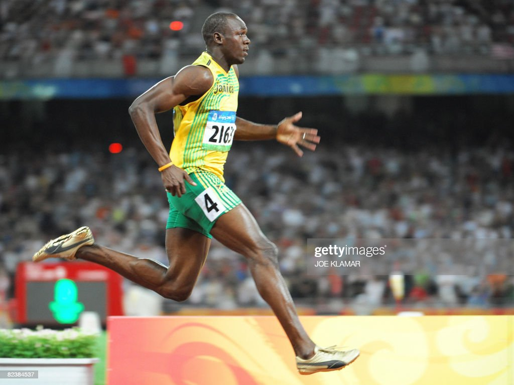 Jamaica's Usain Bolt celebrates after winning the men's 100m semifinal 1 at the National stadium as part of the 2008 Beijing Olympic Games on August 16, 2008. Jamaica's Usain Bolt won ahead of Walter Dix of the US and Trinidad and Tobago's Marc Burns.