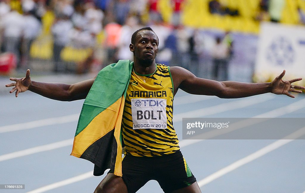 Jamaica's Usain Bolt celebrates after winning the men's 200 metres final at the 2013 IAAF World Championships at the Luzhniki stadium in Moscow on August 17, 2013. AFP PHOTO / OLIVIER MORIN