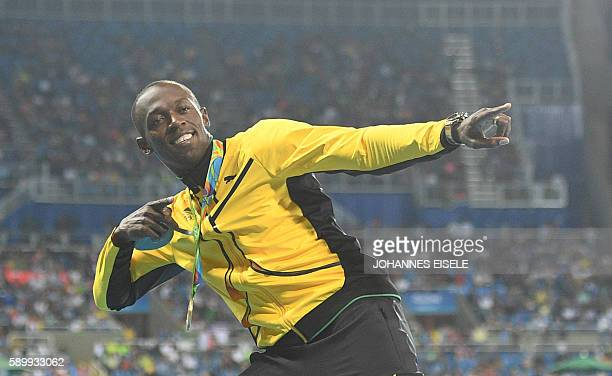 Jamaica's Usain Bolt celebrates during the podium ceremony for the men's 100m during the athletics event at the Rio 2016 Olympic Games at the Olympic...