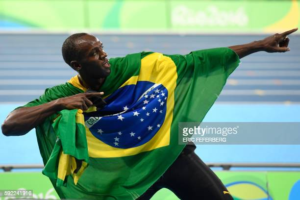 TOPSHOT Jamaica's Usain Bolt celebrates his team's victory at the end of the Men's 4x100m Relay Final during the athletics event at the Rio 2016...