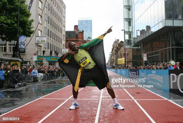 Jamaica's Usain Bolt celebrates winning a the 150m Event on a specially constructed track during the BUPA Great Manchester Run and Great City Games...