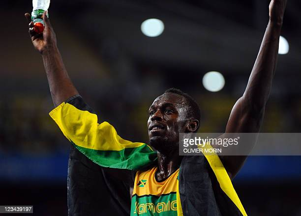 Jamaica's Usain Bolt celebrates winning gold in the men's 200 metres final at the International Association of Athletics Federations World...
