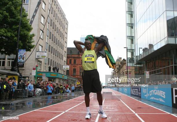 Jamaica's Usain Bolt celebrates winning the 150m Event on a specially constructed track during the BUPA Great Manchester Run and Great City Games in...