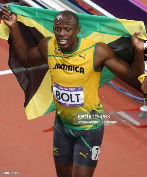 Jamaica's Usain Bolt celebrates winning the Men's 100m Final at the Olympic Stadium on day nine of the London 2012 Olympic Games